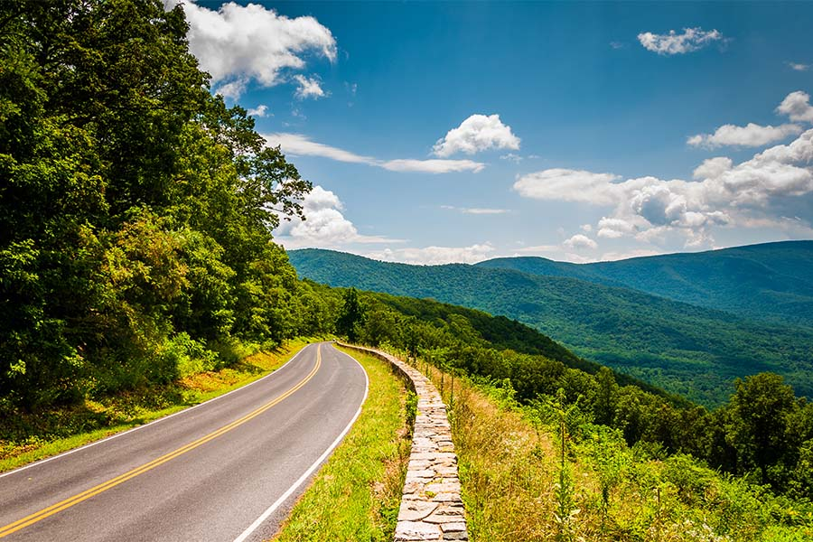 About Our Agency - View Of Skyline Drive And Blue Ridge Mountains On Sunny Day